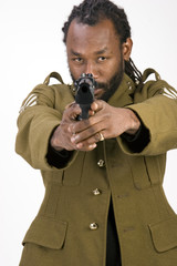 A Black man in a Army jacket with a gun