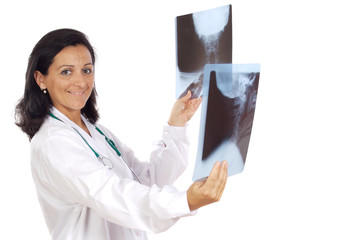 Female doctor looking to x-ray picture over white background