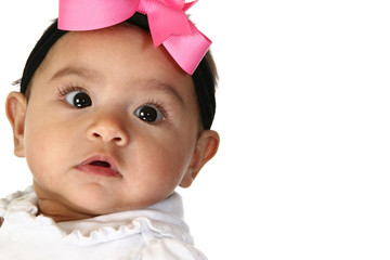 Close up of beautiful Hispanic 3 month old baby girl.