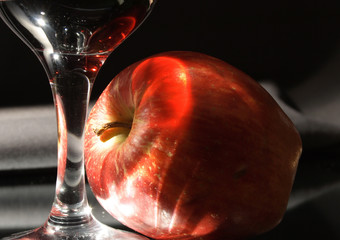 Red wine and red apple