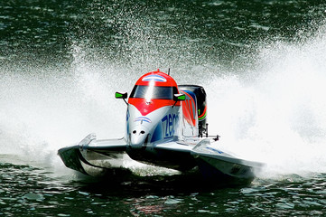 striking hi speed motor boat in action