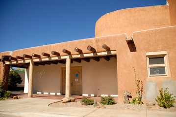 Adobe house on a bright summer day in Taos, New Mexico