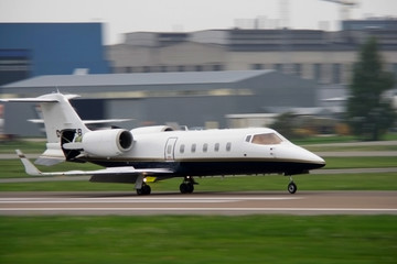 corporate jet landing at airport