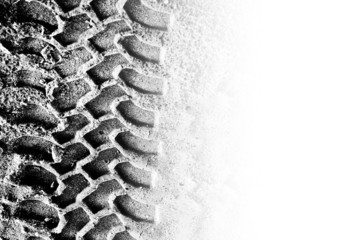 Tyre tread pattern in sand with area of copyspace