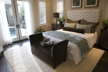Comfortable bedroom and modern decor in a luxury home.