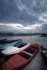 old boat on frozen river Danube in january