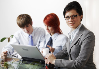 beautiful caucasian business women with young consultant