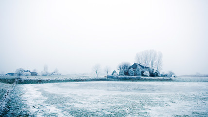 farm house in the middle of winter