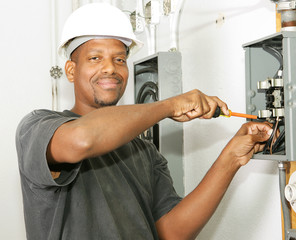 Handsome african american electrician working