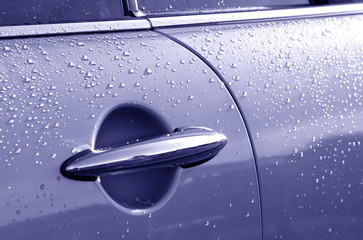 Wall Mural - auto door and lever with raindrops