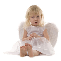 cute sitting blonde girl in white dress and wings of angel