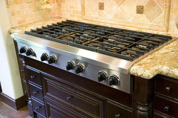 Luxury kitchen with modern stove close-up.