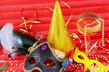 Detail of carnival mask on red background