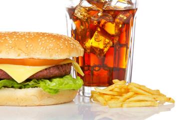 Cheeseburger, soda drink, on white background. Shallow DOF