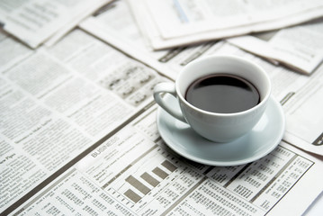 Coffee over newspaper, business