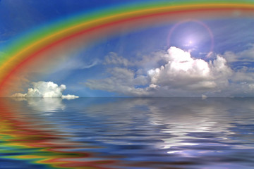 clouds sky and rainbow in the ocean wih flare