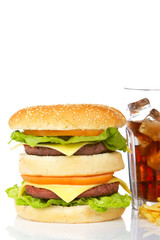 Double cheeseburger and soda, reflected on white background