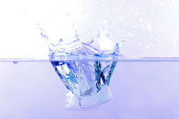 Ice Cube fall in the water .