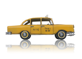 An old vintage taxi cab over a white background