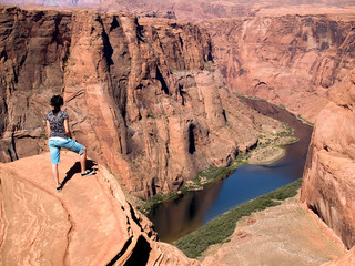 A young woman in her early '20s enjoys hiking the Grand Canyon