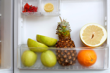An image of various fruits in a refrigerator