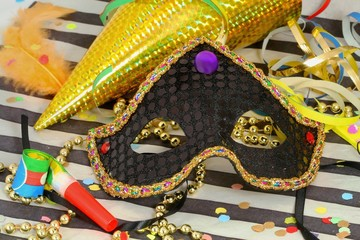 Detail of carnival with mask on color background