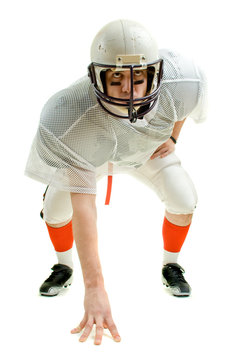 An American football player. Three point stance.