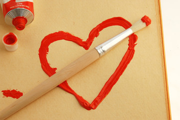 Painted red heart with brush.