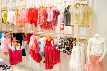 Image of children's clothes in a shop.