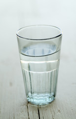 glass of water on a white wooden surface with SDF