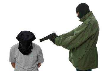 Kidnapper holding a gun to the head of a hooded man.
