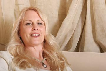 Beautiful mature blond woman smiling