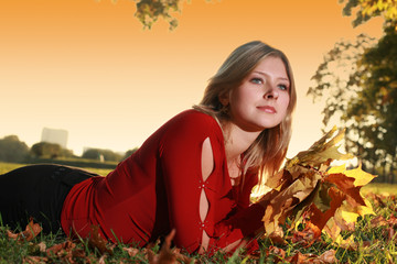 Wall Mural - Young woman in park with bouquet of yellow autumn leaves