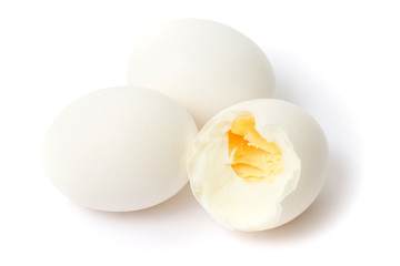 Three boiled eggs on white background
