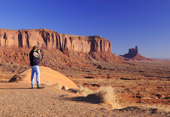 Young male is photographing Monument Valley