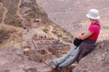Young woman tourist by ruin in Peru