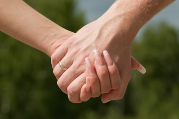 Close up of female and man's hands.
