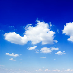 The blue sky is covered by fluffy clouds.