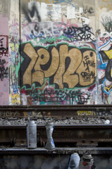 spray paint cans sitting on railroad tracks