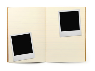 lined exercise book and two photo frames on white,