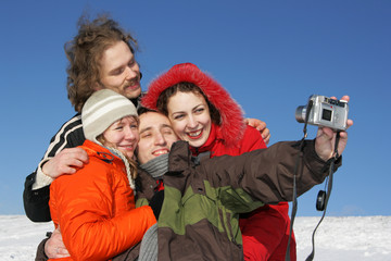 People taking a photo in winter