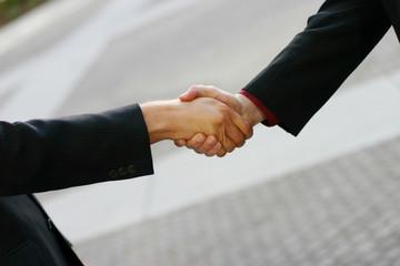 close up of handshake between two businessmen
