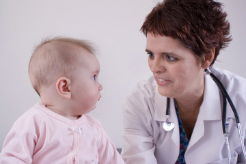 seven month old baby with her pediatrician (high-key)