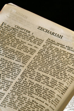 holy bible open to the book of Zechariah in the old testament