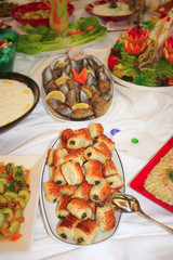 """""""borek"""" on a table full of meals"""