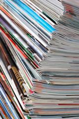 Pile of magazines on white