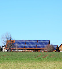 A Photograph of a house with solar panels