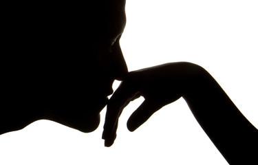 man kissing womens hand  silhouette