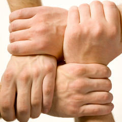 Human hands touching each other over white background