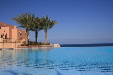 Beautiful blue fresh infinity pool in a villa